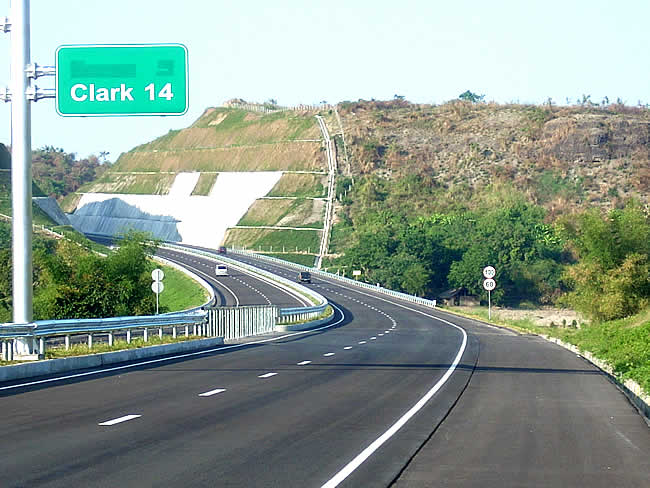 14 Kilometers from the Clark Freeport Exit Heading East on SCTex Approaching a Cut in a Hill for the Expressway